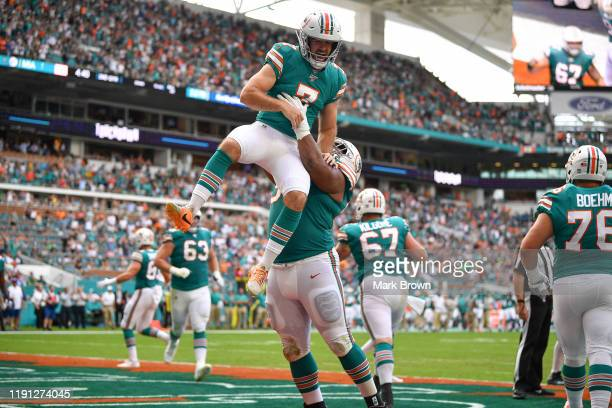 Jason Sanders of the Miami Dolphins celebrates a touchdown pass from a fake field goal against the Philadelphia Eagles in the second quarter at Hard...