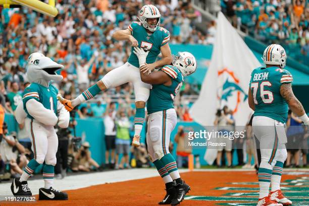 Jason Sanders of the Miami Dolphins celebrates with Christian Wilkins after catching a touchdown pass against the Philadelphia Eagles during the...