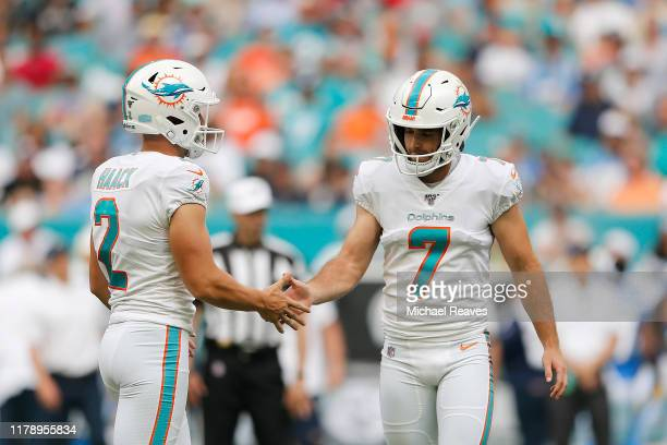 Jason Sanders of the Miami Dolphins celebrates with Matt Haack against the Los Angeles Chargers during the second quarter at Hard Rock Stadium on...