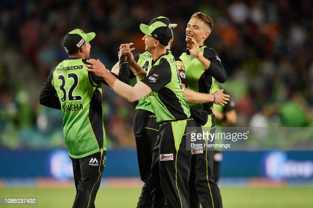 Jason Sangha of the Thunder and Chris Green of the Thunder celebrate taking the wicket of Marcus Stoinis of the Stars during the Sydney Thunder v...
