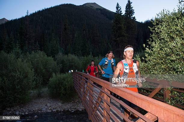 Jason Schlarb of Durango leads a pacesetter and Kilian Jornet near mile 67 of the Hardrock 100 ultra distance run through the San Juan Mountains on...