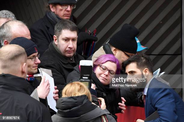 Jason Schwartzman signs autographs for fans as he leaves after the 'Isle of Dogs' press conference during the 68th Berlinale International Film...