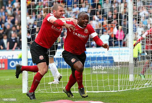 Jason Scotland of Barnsley celebrates scoring his side's second goal with team mates during the npower Championship match between Huddersfield Town...