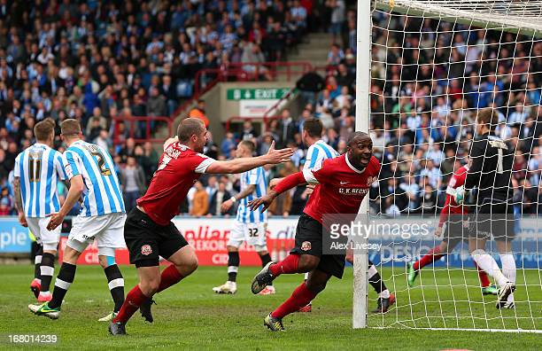 Jason Scotland of Barnsley celebrates with Stephen Dawson after scoring during the npower Championship match between Huddersfield Town and Barnsley...