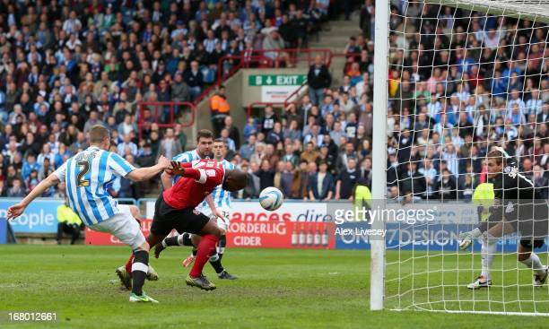 Jason Scotland of Barnsley scores his side's second goal during the npower Championship match between Huddersfield Town and Barnsley at John Smith's...