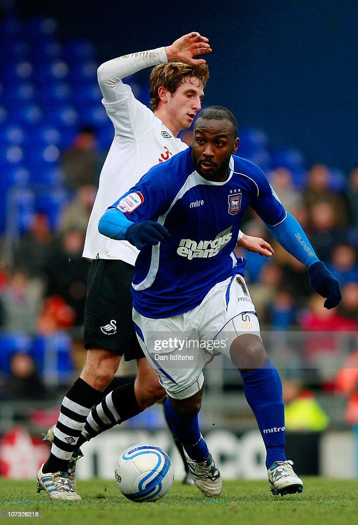Jason Scotland (R) of Ipswich battles for the ball against Joe Allen of Swansea during the npower Championship match between Ipswich Town and Swansea City at Portman Road on December 4, 2010 in Ipswich, England.