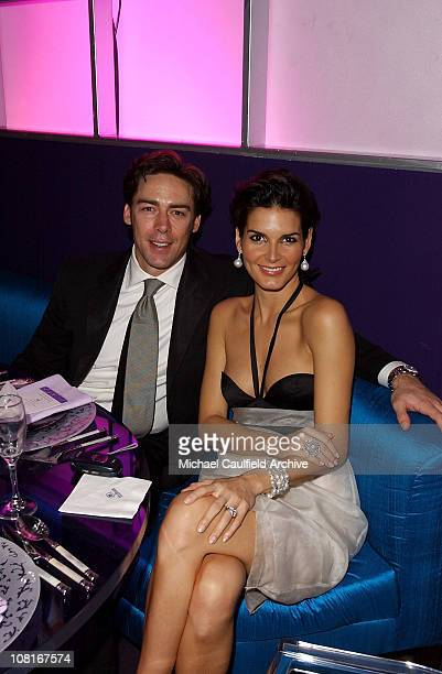 Jason Sehorn and Angie Harmon during 2005 InStyle/Warner Bros Golden Globes Party Inside at The Palm Court at the Beverly Hilton in Beverly Hills...
