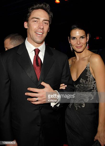 Jason Sehorn and Angie Harmon during InStyle Warner Bros 2006 Golden Globes After Party Inside at Beverly Hilton in Beverly Hills California United...