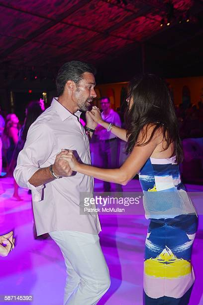 Jason Sehorn and Meghann Gunderman dance at the 2016 Hamptons Paddle Party for Pink Benefiting the Breast Cancer Research Foundation at Fairview on...