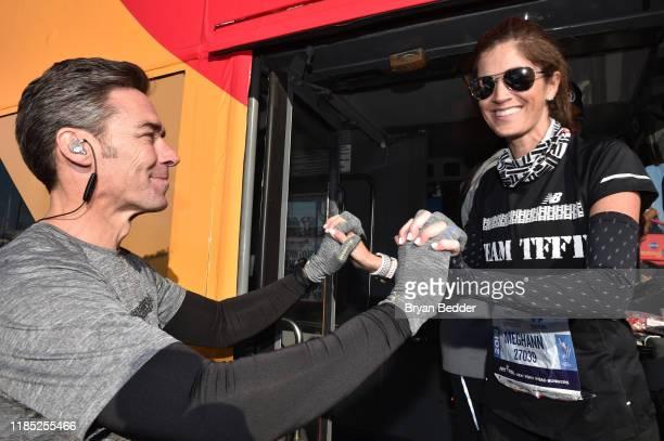 Jason Sehorn and Meghann Gunderman pose before the start of the 2019 TCS New York City Marathon on November 03 2019 in New York City