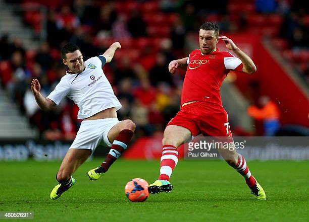 Jason Shackell of Burnley tackles Rickie Lambert of Southampton during the FA Cup with Budweiser Third round match between Southampton and Burnley at...