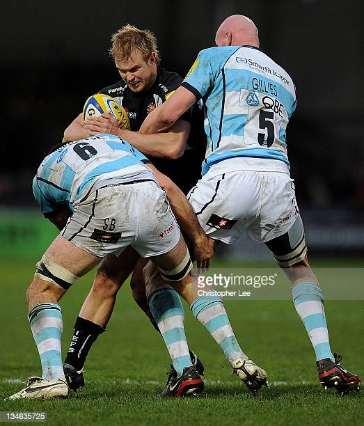 Jason Shoemark of Exeter is tackled by Sam Betty and Craig Gillies of Worcester during the AVIVA Premiership match between match between Exeter...