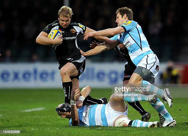 Jason Shoemark of Exeter is tackled by Shaun Perry and Errie Claassens of Worcester during the AVIVA Premiership match between match between Exeter...