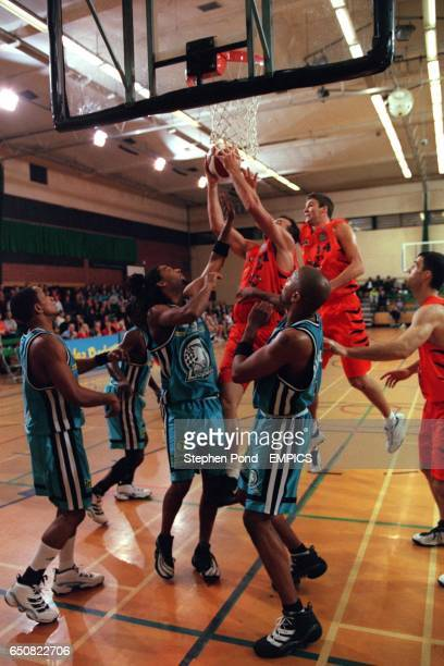 Jason Siemon of Thames Valley Tigers beats the defence of the London Leopards to make a basket