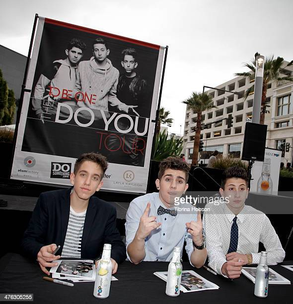 Jason Smith Madison Alamia and Mikey Fusco of To Be One attend a meet and greet with their fans at Glendale Galleria on March 2 2014 in Glendale...