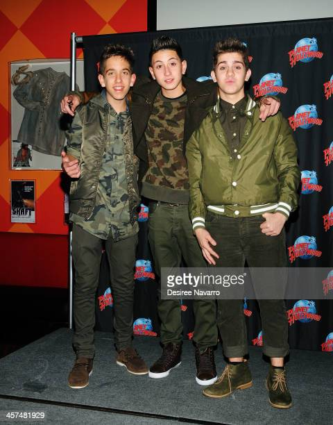Jason Smith Mikey Fusco and Madison Alamia of To Be One visit Planet Hollywood Times Square on December 17 2013 in New York City