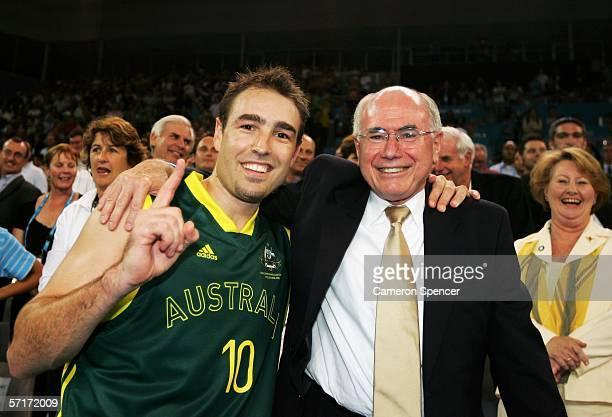 Jason Smith of Australia celebrates with Australian Prime Minister John Howard after the Australian team's victory in the men's gold medal basketball...