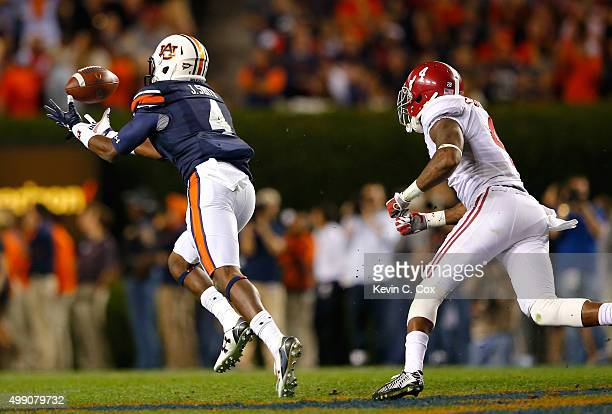Jason Smith of the Auburn Tigers pulls in this reception and takes it for a touchdown against Eddie Jackson of the Alabama Crimson Tide at Jordan...