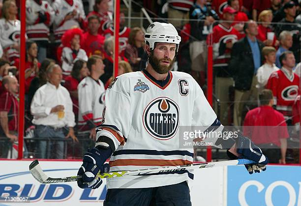 Jason Smith of the Edmonton Oilers looks on during a break in game action against the Carolina Hurricanes during game seven of the 2006 NHL Stanley...
