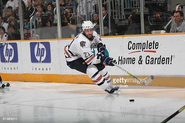 Jason Smith of the Edmonton Oilers skates with the puck during Game 2 of the Western Conference Semifinals against the San Jose Sharks on May 8, 2006...