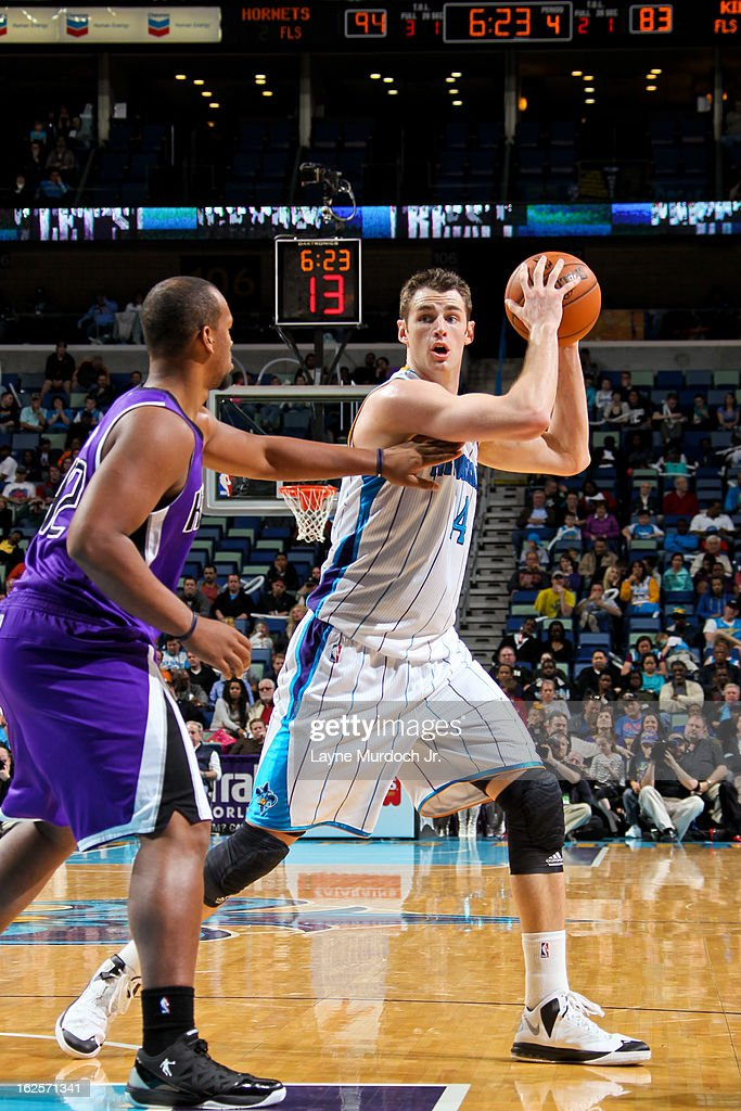 Jason Smith #14 of the New Orleans Hornets controls the ball against Chuck Hayes #42 of the Sacramento Kings on February 24, 2013 at the New Orleans Arena in New Orleans, Louisiana.