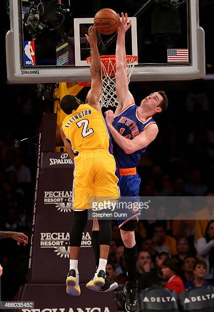 Jason Smith of the New York Knicks blocks a shot attempt by Wayne Elington of the Los Angeles Lakers at Staples Center on March 12 2015 in Los...