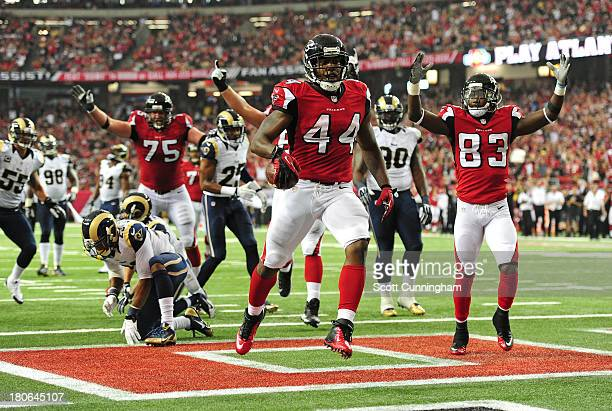 Jason Snelling of the Atlanta Falcons scores a 4th quarter touchdown against the St. Louis Rams at the Georgia Dome on September 15, 2013 in Atlanta,...