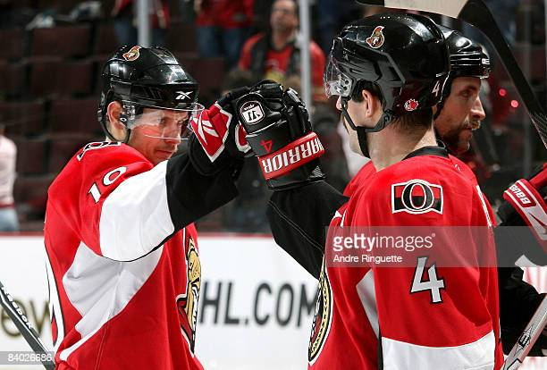 Jason Spezza and Chris Phillips of the Ottawa Senators high five each other after their win against the Tampa Bay Lightning at Scotiabank Place on...