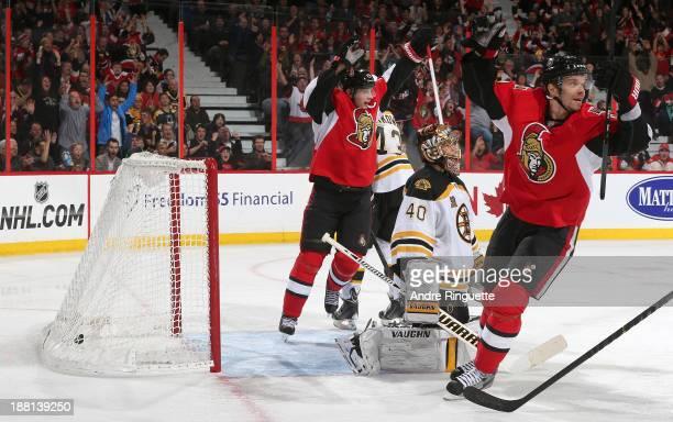 Jason Spezza and Milan Michalek of the Ottawa Senators celebrate a third period goal against Tuukka Rask of the Boston Bruins at Canadian Tire Centre...