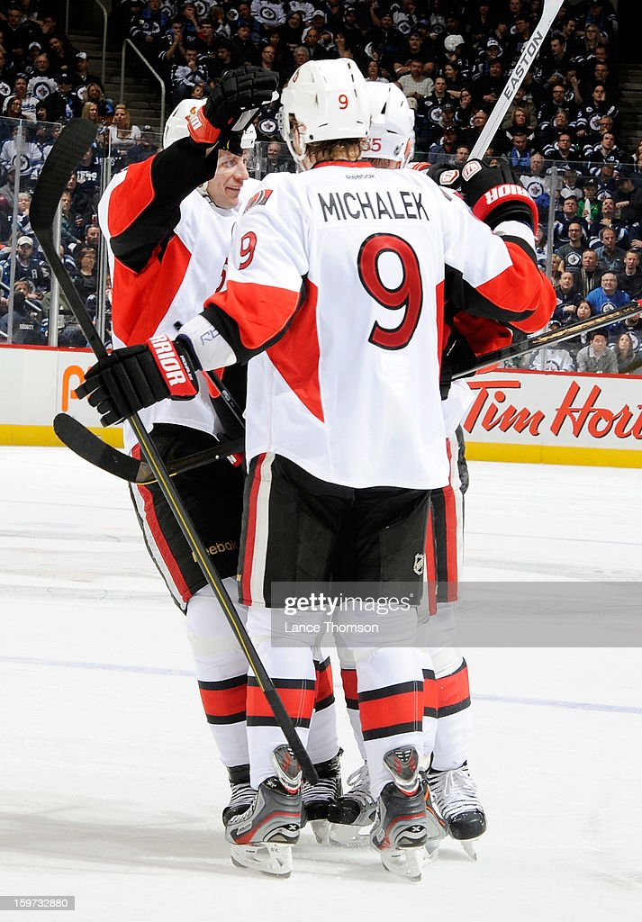 Jason Spezza #19, Milan Michalek #9 and Sergei Gonchar #55 of the Ottawa Senators celebrate a third period goal against the Winnipeg Jets at the MTS Centre on January 19, 2013 in Winnipeg, Manitoba, Canada.