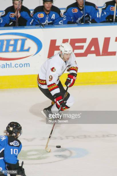 Jason Spezza of the Binghamton Senators skates the puck through the neutral zone against the Bridgeport Sound Tigers during the American Hockey...