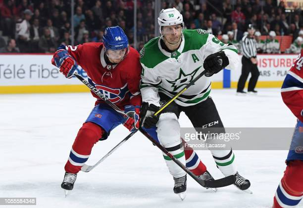 Jason Spezza of the Dallas Stars battles for position during his 1000th NHL game against Artturi Lehkonen of the Montreal Canadiens at the Bell...