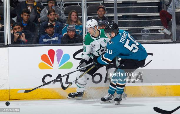 Jason Spezza of the Dallas Stars skates after the puck against Chris Tierney of the San Jose Sharks at SAP Center on February 18 2018 in San Jose...