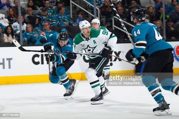 Jason Spezza of the Dallas Stars skates against Brenden Dillon and MarcEdouard Vlasic of the San Jose Sharks at SAP Center on February 18 2018 in San...