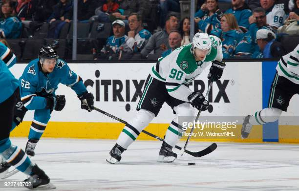 Jason Spezza of the Dallas Stars skates with the puck against Kevin Labanc of the San Jose Sharks at SAP Center on February 18 2018 in San Jose...