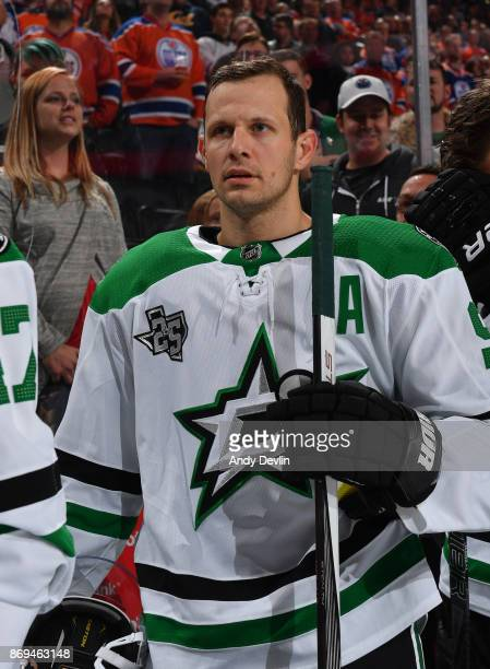 Jason Spezza of the Dallas Stars stands for the singing of the national anthem prior to the game against the Edmonton Oilers on October 26 2017 at...