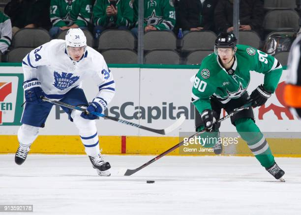 Jason Spezza of the Dallas Stars tries to keep the puck away against Auston Matthews of the Toronto Maple Leafs at the American Airlines Center on...