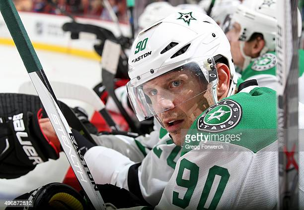 Jason Spezza of the Dallas Stars watches action on the ice from the bench area during a NHL game against the Carolina Hurricanes at PNC Arena on...