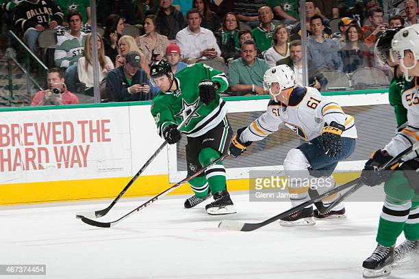 Jason Spezza of the Dallas Stars winds up a shot against Andre Benoit of the Buffalo Sabres at the American Airlines Center on March 23 2015 in...