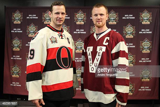 Jason Spezza of the Ottawa Senators and Henrik Sedin the Vancouver Canucks pose with NHL Heritage Classic jerseys during the official unveiling at...