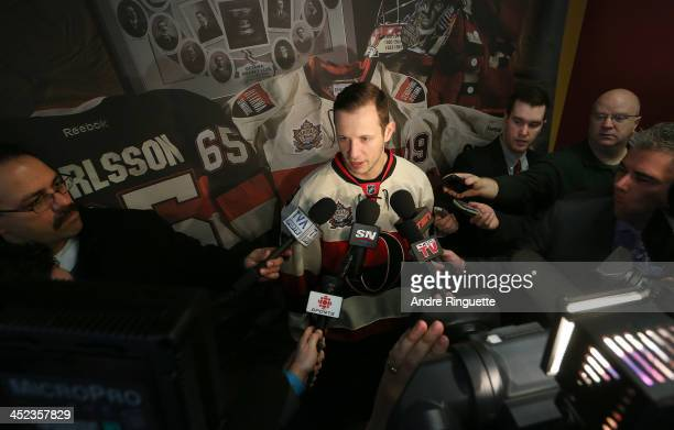 Jason Spezza of the Ottawa Senators answers questions from the media during the unveiling of the NHL Heritage Classic jerseys at Canadian Tire Centre...
