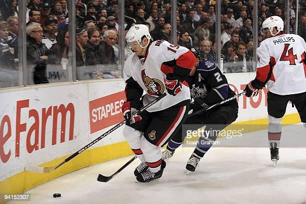 Jason Spezza of the Ottawa Senators battles the puck alongside the boards against Matt Greene of the Los Angeles Kings during the game on December 3,...