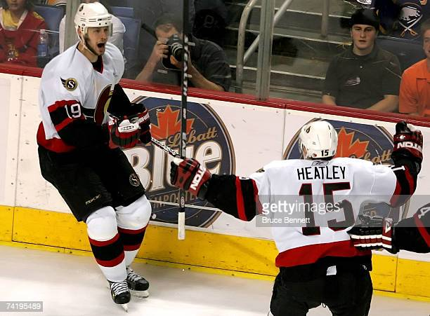 Jason Spezza of the Ottawa Senators celebrates his goal with teammate Dany Heatley during the second period of Game 5 of the 2007 Eastern Conference...