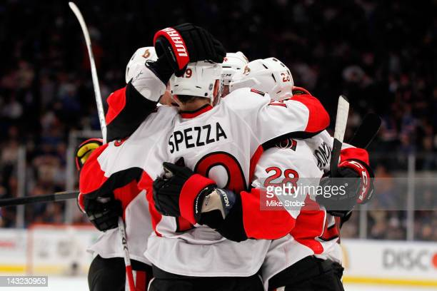 Jason Spezza of the Ottawa Senators celebrates with his teammates after scoring an open net goal against the New York Rangers in the third period in...