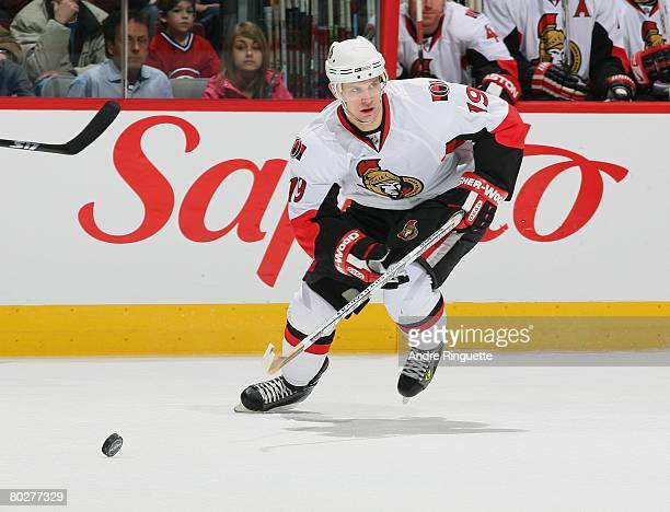 Jason Spezza of the Ottawa Senators chases a loose puck against the Montreal Canadiens at the Bell Centre on March 13, 2008 in Montreal, Quebec,...