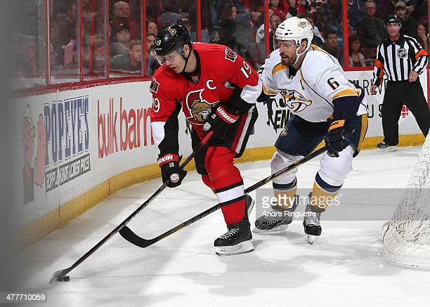 Jason Spezza of the Ottawa Senators controls the puck along the boards against Shea Weber of the Nashville Predators at Canadian Tire Centre on March...