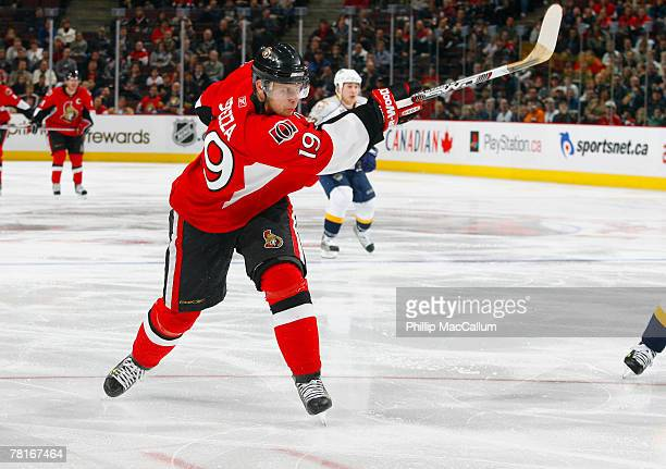 Jason Spezza of the Ottawa Senators fires a slapshot from the top of the circle towards the net of the Nashville Predators during second period...