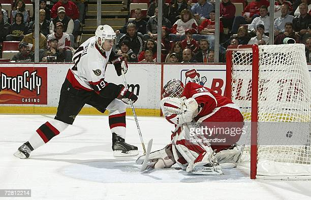 Jason Spezza of the Ottawa Senators scores his second goal of the game against Dominik Hasek of the Detroit Red Wings at Joe Louis Arena December 12...