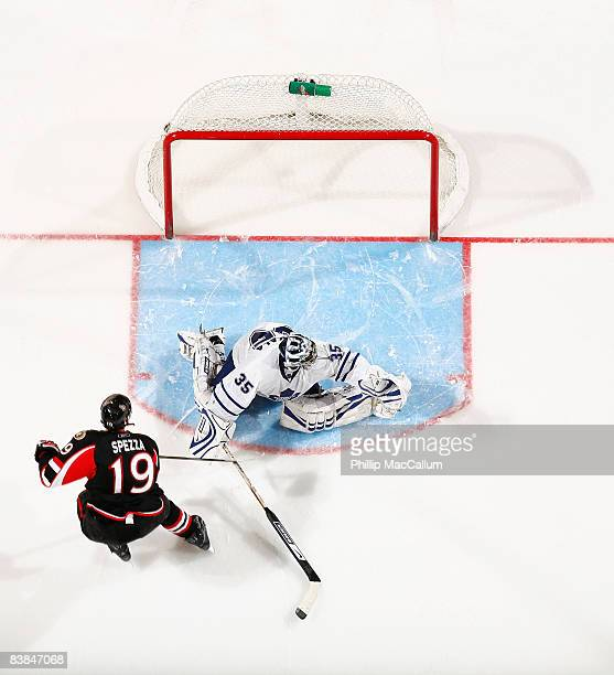 Jason Spezza of the Ottawa Senators scores the game winning goal on his shootout attempt against Vesa Toskala of the Toronto Maple Leafs in a game on...