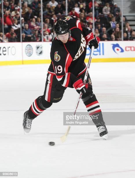 Jason Spezza of the Ottawa Senators shoots the puck against the Buffalo Sabres at Scotiabank Place on November 21 2009 in Ottawa Ontario Canada